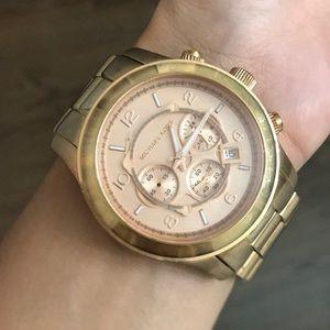 Michael Kors rose gold large face watch